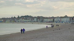 Quiet beach in evening in Weymouth, England Stock Footage