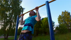 Teenager pulls on the bar. teenager Sports lifestyle Stock Footage