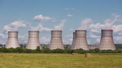 Huge cooling towers of power plant in the summer heat and air evaporation - stock footage