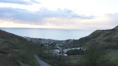 English coastal village in-between hills Stock Footage