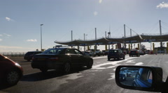Cars lining up at Customs at Eurotunnel Stock Footage