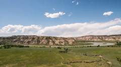 Time lapse - clouds and people speed around river in canyon lands Stock Footage