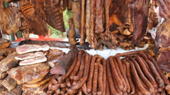 Smoked dried Bacon ham and sausages  at the market  Stock Footage