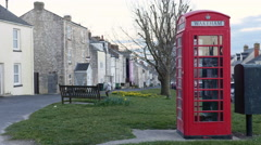 Red phone booth in Weymouth, England. Stock Footage