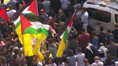 Ramallah, Palestine, a demonstration with Palestinian and Fatah flags Stock Footage