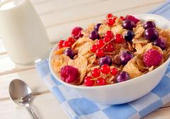 Cereals and berry fruit in bowl Stock Photos