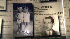 Yad Vashem, Israel's Holocaust Memorial, Hall of Names, pictures of the perished Stock Footage