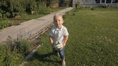 Happy Little Boy Playing With Ball In The Garden. Little Kid Playing Soceer Stock Footage