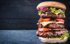 Triple American burger - stock photo