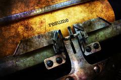 Resume on typewriter grunge concept - stock illustration