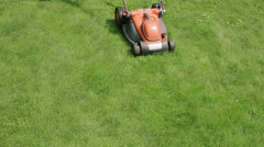 Lawn mower cutting the grass Stock Footage