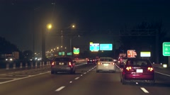 Driving in highway trafic at night Stock Footage