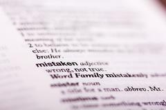 Close up of words in a dictionary - stock photo