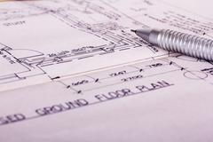 Drawing equipment with detailed architects house plans Stock Photos