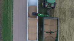 Wheat Harvest John Deere Grain Cart and Semi Truck Top View  - Drone - stock footage