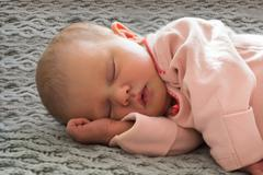 Close-up Of A Baby Girl Sleeping Peacefully - stock photo