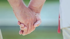 Seniors slow motion hand separation Stock Footage