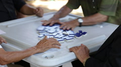 Adults Playing a Game of Dominos Stock Footage