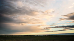 Time lapse - Strange green and yellow clouds move towards sunrise over prairie Stock Footage