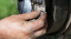 Repair of brake drum closeup Stock Footage