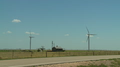 Windmills and Old House in Oklahoma Panhandle Stock Footage