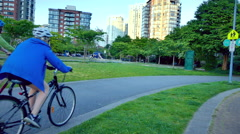 Group of people bicycling  park Vancouver Stock Footage