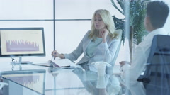 4K Businesswoman in a meeting with colleagues in modern glass office Stock Footage