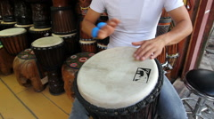 Chinese man playing djembe in Old Town of Lijiang,,Yunnan, China. Stock Footage
