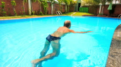 Closeup Backside Old Man Swims in Pool Azure Water Stock Footage