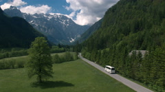 Aerial - Tracking shot of a bus driving through the famous Logar valley Stock Footage