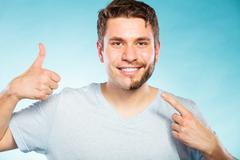 Happy man with half shaved face beard hair. - stock photo