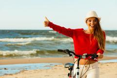 Fashionable girl with bike outdoor. Stock Photos