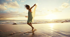 Ethnic Woman Walking on Beach at Sunset - stock footage