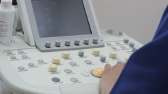 Ultrasound edevice keyboard closeup, hands of doctor clicks on the button Stock Footage