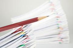 Close up pencil on document have blur pile overload paperwork Stock Photos