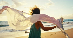 Ethnic Woman Walking on Beach at Sunset Stock Footage