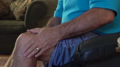 Man With Arthritis Pain And Aching Joints Rubbing Knee and Leg.mp4 Stock Footage
