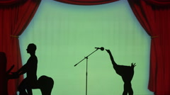 Silhouette of an ostrich that sings in the microphone - stock footage