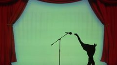 Silhouette of an ostrich that sings in the microphone Stock Footage