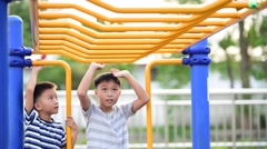 Boys playing in play ground. Stock Footage