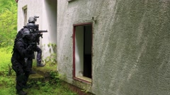 Slow Motion – A Special Force Team walk in a bedraggled house Stock Footage