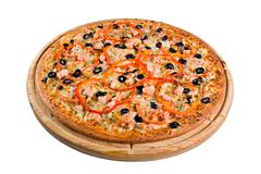 Pizza with salmon on a wooden board Stock Photos