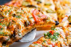Slice of Delicious fresh hot Pizza with mushrooms Stock Photos