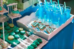 Candy bar on wedding ceremony with a lot of different candies and beverages Stock Photos