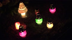 Cemetery at night with colorful candles burning. Focus in. 4K Stock Footage