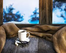 White cup of coffee or tea, lavender flowers and natural gunny cloth. Stock Photos