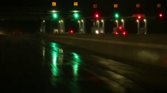 Driving Past Toll Booth on Rainy Night Stock Video Stock Footage