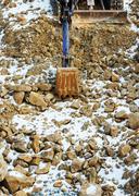 Small bulldozer excavator at construction site. Stock Photos