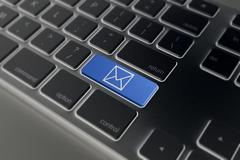 E-mail envelope in a computer key - stock illustration