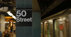 New York City Subway Train Approaches 50th Street Platform Stock Footage